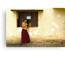 Exiled monk on his mobile phone Canvas Print