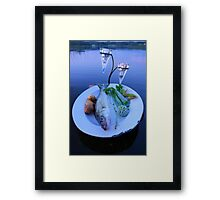 Fresh fish catch on a plate with vegetables Framed Print