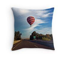 HOT AIR BALLOON OVER THE HIGHWAY Throw Pillow