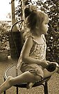 Profile Of A  Little Girl In Sepia by Evita