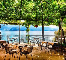 Restaurant Tables on a Patio Under a Trellis with a Lake View by George Oze