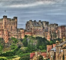 Bamburgh Castle. View from the Village. by Sue Smith
