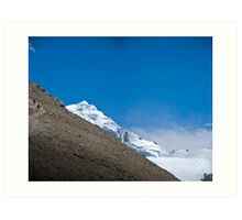 Trekkers walking up hill side with snow capped mountain in the background  Art Print