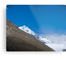 Trekkers walking up hill side with snow capped mountain in the background  Metal Print