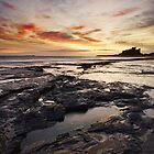 Bamburgh Sunrise in Winter by Robin Whalley
