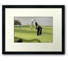 Golfers in the rain Framed Print