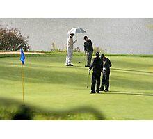 Golfers in the rain Photographic Print