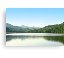 Mirrored peaks at the horison. Canvas Print