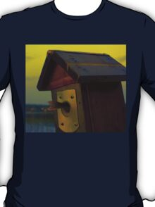 A fishtail coming out from a birdhouse entrance T-Shirt