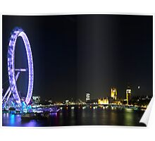 The London Eye in motion at night. Poster
