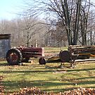 Old Tractor an saw by cdcantrell