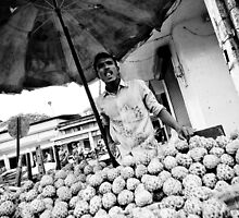 Vendor in Stall - Goan faces by Chinua Ford
