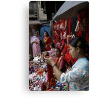 Selling decorative braids in Kathmandu, Nepal Canvas Print