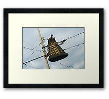 Dalek in a lamp post Framed Print