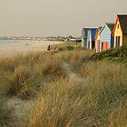 Beach huts bathing in evening sun. by Bernard (Ben)  Bosmans