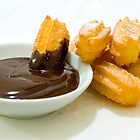 Churros in chocolate sauce by Anika Schmotter