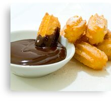 Churros in chocolate sauce Canvas Print