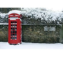 red phone box on a snowy London Photographic Print