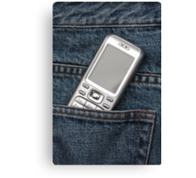 Cellphone in blue jeans Canvas Print