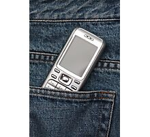 Cellphone in blue jeans Photographic Print