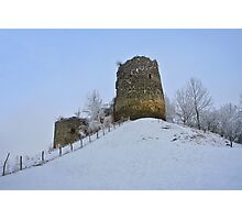 Old medieval fortress on the snowy hill. Photographic Print