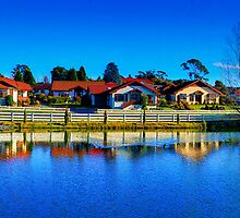 Tasmania - Across the lake at Grindelwald village by Geoffrey Thomas