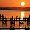Orange surises or sunsets over piers/jetties