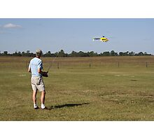 Flying a Radio Controlled Helicopter Photographic Print