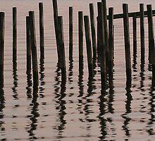 Reflected Poles at Sunrise by JGetsinger