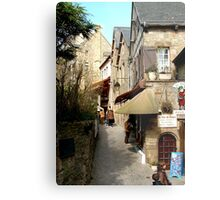 The narrow streets of Mont St Michel, France  Metal Print