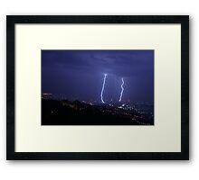 Lightning during a wild storm Framed Print
