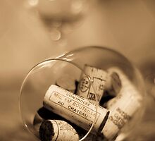 Glass of wine with cork by Denis Charbonnier