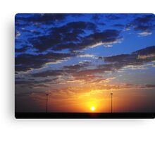 Sunset behind the wire Canvas Print