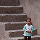 Arch & Stair Series - Local child on steps (Morocco) by Christine Oakley