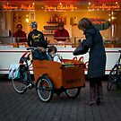 In the 'bakfiets' to the 'oliebollenkraam' by steppeland
