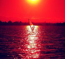 A surfer on Shoreline lake, Mountain View, California. Sunset by Igor Pozdnyakov