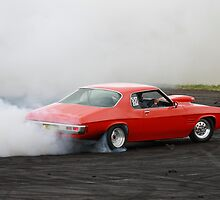 Burning rubber - Monaro style. by Dean Perkins