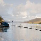 A Land Rover and canoe share the water at Coniston. by Simon Hathaway
