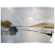 A Land Rover and canoe share the water at Coniston. Poster
