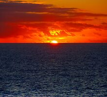 Sunrise in the Caribbean by Roland Pozo