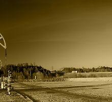 Oil pumps on a oil field. by bashta