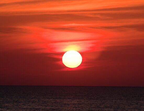 Sunset Over The Pacific Ocean by Jarede Schmetterer