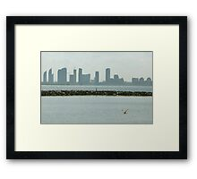 dive and divide on lake's horizon Framed Print