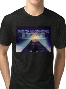 She's working at the pyramid Tri-blend T-Shirt