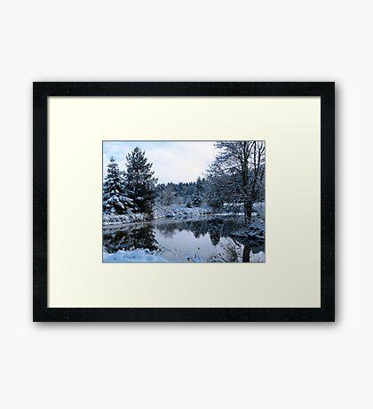 snowy pond Framed Print