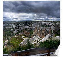 A bench overlooking valleys in Cappadocia, Turkey Poster