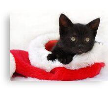 black kitten in a santa hat Canvas Print