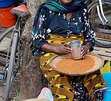 African Women selling seed at marketplace by Maria Kumlander