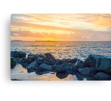 yellow sunset and soft waves at beal rocky beach Canvas Print