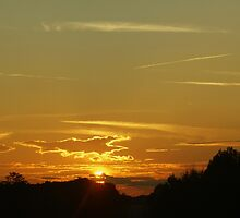 Sundown And Contrails by Linda Yates